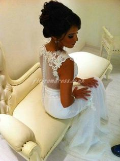 lace wedding dress with sheer back. Classic and feminine but not showy.