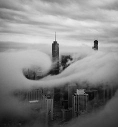 Photo and caption by Jian Lou    This was taken on 95th floor of John Hancock Building. I was fortunate to watch fast moving low hanging clouds swept through the city buildings during late afternoon. A cloud swirled around the Trump Tower for a very brief moment for me to capture two frames. This is one of the two.    Location: John Hancock Building Chicago IL USA