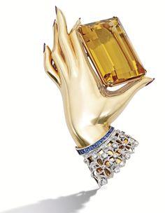 Gold, Platinum, Citrine, Ruby, Diamond and Sapphire Clip-Brooch circa 1940.