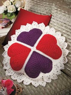 Victorian Sweetheart Pillow Crochet Pattern Download from e-PatternsCentral.com -- Four hearts joined at the points and edged with gorgeous lace create a romantic Valentine's Day home-decor accent piece.