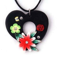 'Polymer/Fimo Heart Necklace with Rhinestone Accents' is going up for auction at  8am Wed, Sep 5 with a starting bid of $5.
