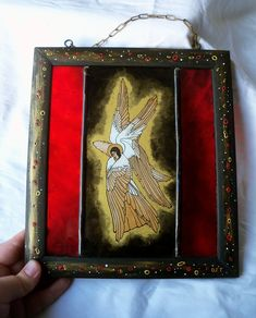 Reverse painting on glass icon depicting a 'SERAPH' angel