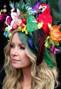 Designer Anouska Lancaster's headpiece incorporated parrots, flowers and other…