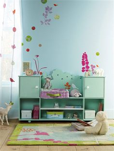 pastels for the playroom love this charming palette, the blue side board and the wall decals, so cute.
