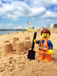 LEGO movie star Emmet enjoying the hottest day of the year on Southsea beach, Hampshire.  Issue date: Thursday July 17, 2014 Photo credit should read: Andrew Whyte/LEGO/PA