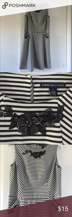 American Living Black and White Stripe Dress Sleeveless, fit and flare style. Dress has slash side pockets and no zipper. Just pull on. Appliqués were added on and can be easily removed with a little heat. Needed to wear a B&W dress for summer special occasion so I added these. Always wore dress with a belt. I just felt it needed one.   Worn just a few times. Comes from non smoking home. Excellent condition. American Living Dresses