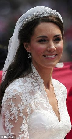 Close up: The dress was embelished with custom-made lace, and the Duchess changed into a simpled Alexander McQueen dress for the wedding reception