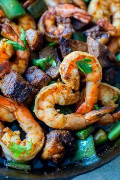 Cajun Butter Steak and Shrimp Skillet Recipe - Sweet Cs Designs Cajun Recipes, Fish Recipes, Seafood Recipes, Beef Recipes, Dinner Recipes, Cooking Recipes, Healthy Recipes, Dinner Ideas, Cajun Food