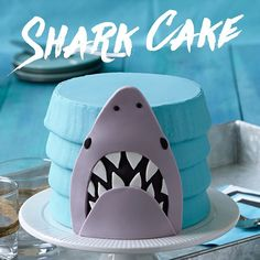 #sharkweek is just getting started so you still have plenty of time to have a viewing party! Serve this easy-to-decorate Shark Cake and it will be sure to grab your guests! Instructions in the link in our bio. #wiltoncakes #cakedecorating #fondant