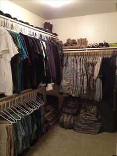 Husband's side of our closet. ACUs, Army gear, hats and all!