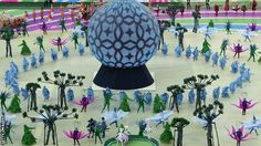 Dancers dressed as trees and flowers paid tribute to Brazil's nature in one of three acts of the opening ceremony