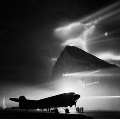 British Overseas Airways Corporation (BOAC) Douglas Dakota at Gibraltar, silhouetted by searchlights on the Rock. Photo by Royal Air Force official photographer