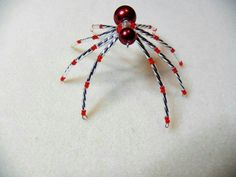 Red and silver beaded spider