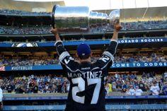 Alec Martinez holds up Stanley Cup at Dodger Stadium - June 17,2014