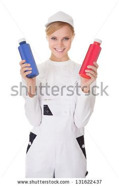 Professional young painter woman holding two buckets of paint. Isolated on white