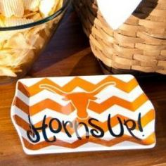 A high-scoring gift that  tops every fan's list, the University of Texas 8-inch Accessory Tray is a power  player! The bold chevron pattern and logo design stylishly celebrate college  colors. Ideal for dorm rooms, desks, consoles and more, this catch-all is a  multi-functional must and makes the perfect gift for grads, coaches, friends  and family.
