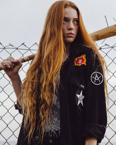 Badass ginger with a bat and jacket with patches.