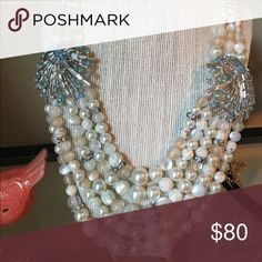 Multi layer pearl and crystal statement necklace Made with layers of pearls and adorned with blue crystal broaches. Nickel free Jewelry Necklaces