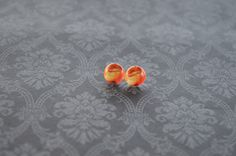 A personal favorite from my Etsy shop https://www.etsy.com/listing/247148226/lion-king-stud-earrings-10mm