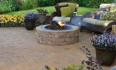 Pavestone Rumblestone Fire pit with tray for wood burning use or insert a gas kit. This is a build your own style fire pit, purchasing the pavers by pallet.
