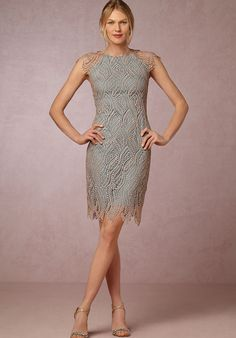 This fitted silhouette of copper-dusted lace is complete with cap-sleeves and an air of retro glamour.
