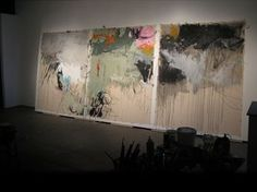 Jason Craighead. beautiful painting yet the thing that draws me in most is his use of tape to display the canvases