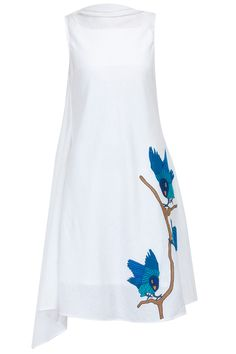 White tailed dress with embroidered blue birds available only at Pernia's Pop-Up Shop.