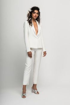 This chic wedding pantsuit features a structured, silk crepe suit jacket with hidden closure and is paired with silk crepe cropped suit pants. The perfect choice for the Bride who wants to stand out and showcase her individual style on her wedding day. White Wedding Suit, White Bridal, Wedding Suits, Wedding Wear, Bridal Wedding Dresses, Bridal Style, Bridal Shoot, Wedding Pantsuit, White Suits