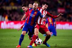 Javier Mascherano (C) of FC Barcelona fights for the ball with Lucas Hernandez (L) and Stefan Savic (R) of Atletico de Madrid during the Copa del Rey semi-final second leg match between FC Barcelona and Atletico de Madrid at Camp Nou on February 7, 2017 in Barcelona, Catalonia.