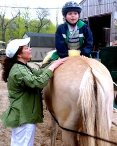 #‎Hippotherapy‬, or horse therapy, has been known help ‪#‎children‬ with physical or cognitive ‪#‎disabilities‬.
