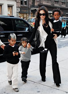 Angelina Jolie and kids #hotinaminivan