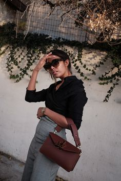 storm wears jw anderson brown bag with jacquemus pants and celine sunnies in silver lake for vintage la