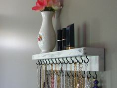 Jewelry Storage by BlackForestCottage on Etsy, $29.00....could make for a fraction of the cost