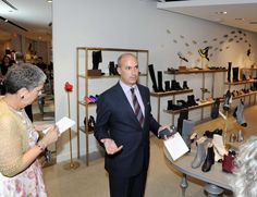 Gold pumps with Hermes-like wings, red flaming heels and bejeweled boots set the tone for opening night of Saks Fifth Avenue's first shoes-only store, branded as 10022-SHOE.  Nestled in a corner retail space on East Elm Street, a short strut from Saks' original Greenwich Avenue location, the new store welcomed 300 guests Wednesday evening with a fresh flower-laden wall and line of tuxedo-clad greeters.  Joe Gambino, Saks Shops at Greenwich general manager and vice president, is a…