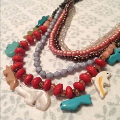 Critter tribal necklace Bronze toned strands with cute little stone critters and beads. Jewelry Necklaces