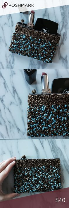 Brown mini 👛 Elegant handmade mini clutch or wallet or pouch... honestly used it for all. Was purchased in Europe and doesn't include a brand name... very well kept condition just like new. (DOESNT INCLUDE THE ACCESSORIES inside the clutch was taken for a picture to show you what can fit) but... I will include a FREE head piece I purchased to go with the clutch (shown in picture above) last picture shows you kinda how I put my clutch and head piece to use.. any questions comment please 💕…