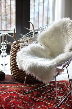Faux Sheep skin on vintage wire chair in bedroom: Sheepskin Rug