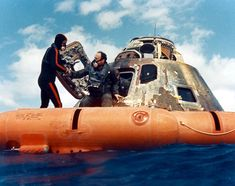 A U.S. Navy diver helps lunar module pilot Ed Mitchell into the recovery raft after splashdown of Apollo 14 on February 9, 1971 / NASA photo, scan by Ed Hengeveld.