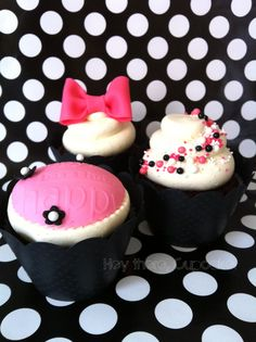 Flickr Cute Hello Kitty themed cupcakes. I love the white one with balls & sprinkles - could colour match for any theme.