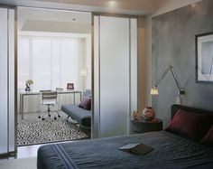Elegat combination of a bedroom and office