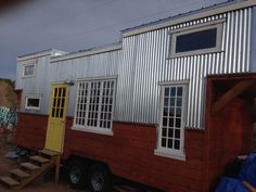 """This hand crafted tiny home is built on a custom fabricated 24 foot trailer that is titled and licensed in the state of New Mexico. The total length is just under 30 feet including the two loft extensions. I am putting this on the market as """"ready to be customized"""" meaning that the exterior will…"""