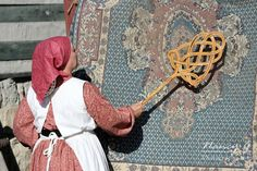 Stock Photo - An older woman beating the dirt from an old wool rug on her porch Western Photography, Older Women, Wool Rug, Pony, Stock Photos, Rugs, Pattern, Pony Horse, Farmhouse Rugs