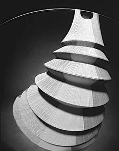 Wearable Art - 3D dress with exaggerated circular silhouette; architectural fashion // Issey Miyake