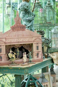 Pink Paper Toy Theater  - looks to be a modern interpretation on a vintage theme. Probably created from photos of an actual building/buildings, digitally color washed in pink and assembled to create this lovely piece; but I'm only guessing since I can't find any info on it other than the picture you see here.  The ladies appear to be images from vintage c1900 actress postcard photos - found at http://romantiskahem.blogspot.com/2012/05/var-och-sommar-glad-inspiration.html