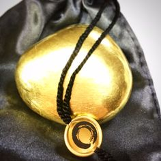 'A golden reminder for yourself and others: We are truly living on a golden globe, sharing the dark and the light - and finally transforming it into a golden state of mind.' EMOTION STONE in 24 K Gold available @krinakingsman