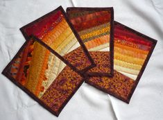 Mug Rug inspiration.  Love finding these small scrap projects...fall, batiks, etc.