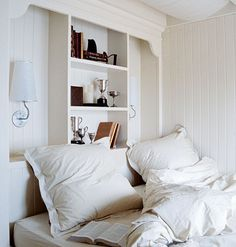 The shelves above this bed serve as both a headboard and a place to display memorabilia.