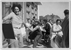 Unknown photographer, Karla Grosch and students on the terrace of the Bauhaus canteen, with stools by Marcel Breuer, c. 1929