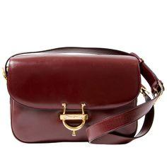 Céline Vintage Burgundy Shoulder Bag   From a collection of rare vintage shoulder bags at https://www.1stdibs.com/fashion/handbags-purses-bags/shoulder-bags/