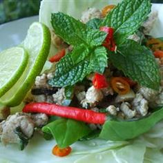Wrap this authentic larb gai in fresh lettuce leaves to contrast the flavors of fish sauce, lime juice, and toasted rice.